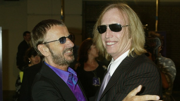 "Musician Ringo Starr, former member of ""The Beatles"" (L) greets