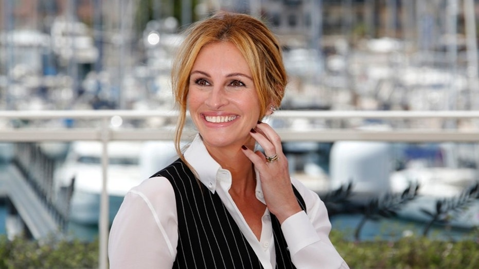"Cast member Julia Roberts poses during a photocall for the film ""Money Monster"" out of competition at the 69th Cannes Film Festival in Cannes, France, May 12, 2016."