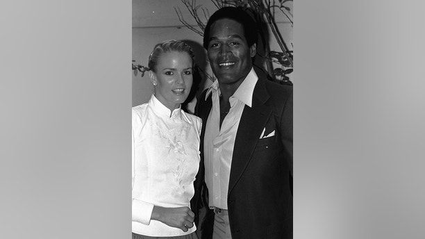 "FILE - In this May 6, 1980, file photo, former football star O.J. Simpson and friend, Nicole Brown get together at party Monday night, in Beverly Hills section of Los Angeles. The couple attended introduction party for a new geometric puzzle invented in Hungary and being distributed here as ""Rubik's Cube."" A Nevada prison official said early Sunday, Oct. 1, 2017, O.J. Simpson, the former football legend and Hollywood star, has been released from a Nevada prison in Lovelock after serving nine years for armed robbery. (AP Photo/Nick Ut, File)"