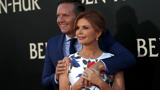 "Executive producer Roma Downey and her husband producer Mark Burnett pose at the premiere for the movie ""Ben-Hur"" at TCL Chinese theatre in Hollywood, California U.S., August 16, 2016."