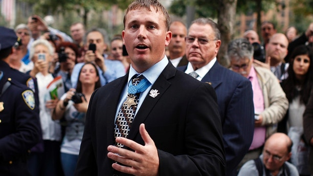 Medal of Honor Recipient Sergeant Dakota Meyer (C) speaks to guests during his visits to the 9/11 Memorial at the World Trade Center site in New York September 21, 2011. Meyer, a Marine sergeant who saved 36 of his comrades' lives during an ambush in Afghanistan was awarded the Medal of Honor on September 15, the first living Marine to win the highest U.S. military decoration since the Vietnam War.