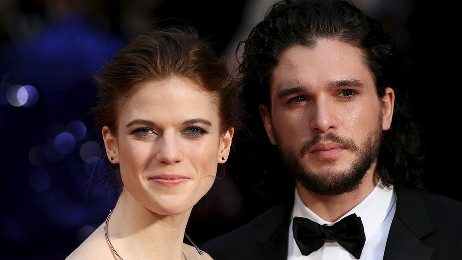 Actor Kit Harington (R) and actress Rose Leslie (L) pose for photographers as they arrive at the Olivier Awards at the Royal Opera House in London, Britain April 3, 2016. REUTERS/Neil Hall - GF10000370199