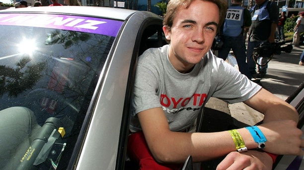 Celebrity race car driver and actor Frankie Muniz poses before winning the 29th Annual Pro/Celebrity Race in Long Beach, California, April 9, 2005.