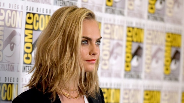 "Cara Delevingne attends the ""Valerian and the City of a Thousand Planets"" press line on day 1 of Comic-Con International on Thursday, July 21, 2016, in San Diego. (Photo by Richard Shotwell/Invision/AP)"