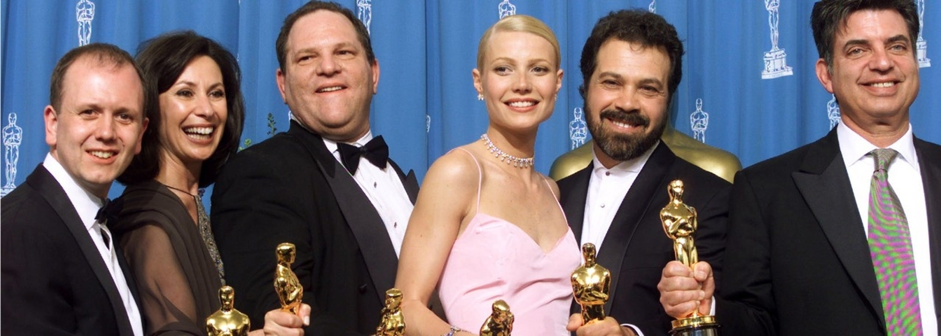 "The producers of the Miramax film ""Shakespeare in Love"" hold their Oscars with the film's star and Best Actress Gwyneth Paltrow, after their film won Best Picture at the 71st Annual Academy Awards ceremony March 21 at the Dorothy Chandler Pavilion in Los Angeles. From left are David Parfitt, Donna Gigliotti, Harvey Weinstein, Paltrow, Edward Zwick and Marc Norman. ""Shakespeare in Love"" won a total of seven Oscar awards.