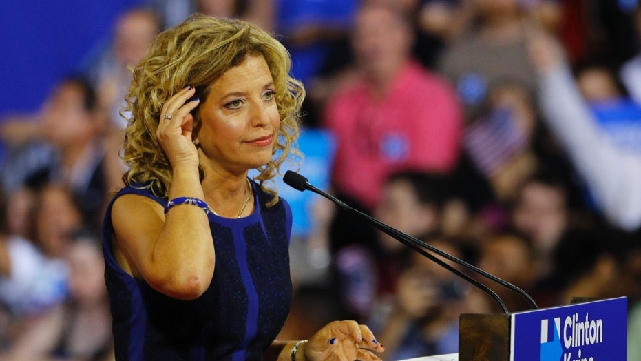 Democratic National Committee (DNC) Chairwoman Debbie Wasserman Schultz speaks at a rally, before the arrival of Democratic U.S. presidential candidate Hillary Clinton and her vice presidential running mate U.S. Senator Tim Kaine, in Miami, Florida, U.S. July 23, 2016. Picture taken July 23, 2016.  REUTERS/Scott Audette   - RTSJFAI