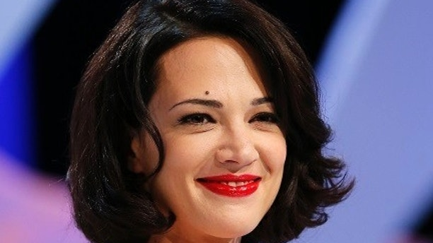 Actress Asia Argento stands on stage during the closing ceremony of the 66th Cannes Film Festival in Cannes May 26, 2013.                  REUTERS/Yves Herman (FRANCE  - Tags: ENTERTAINMENT)   - LR2E95Q1LGHWN