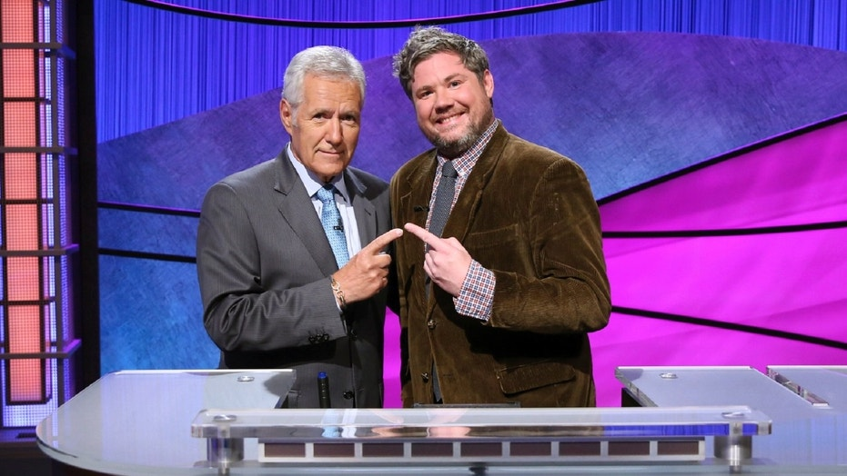"""Jeopardy!"" contestant Austin Rogers, right, had a 12-game winning streak before losing by $51 Thursday night."