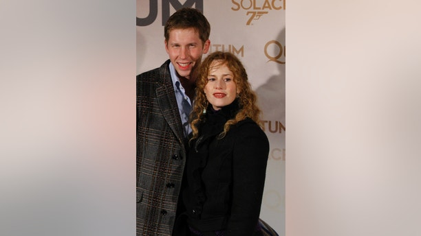 "Actress Florence Darel and her brother Adrien Darel  arrive for the premiere of the latest James Bond movie ""Quantum of Solace"" in Paris, October 30, 2008. REUTERS/Benoit Tessier (FRANCE) - GF2E4AU1RM901"