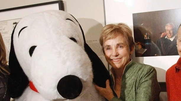 "FILE - In this Oct. 1, 2010, file photo, ""Peanuts"" creator Charles M. Schulz' widow, Jean Schulz, stands with the character ""Snoopy"" during the installation of a portrait of Schulz by photographer Yousuf Karsh, at the National Portrait Gallery, in Washington, D.C. The home of Charles Schulz burned to the ground in the deadly California wildfires but his widow escaped, her stepson said Thursday, Oct. 12, 2017. Jean Schulz, 78, evacuated before flames engulfed her hillside home Monday and is staying with a daughter, Monte Schulz said. (AP Photo/Jacquelyn Martin, File)"