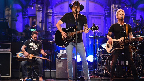 """In this photo provided by NBC, Jason Aldean performs """"I Won't Back Down"""" on """"Saturday Night Live,"""" Saturday, Oct. 7, 2017, in New York. """"Saturday Night Live†has paid tribute to the victims of the Las Vegas mass shooting and the late rock superstar Tom Petty by opening its show with country star Aldean singing one of Petty's songs."""