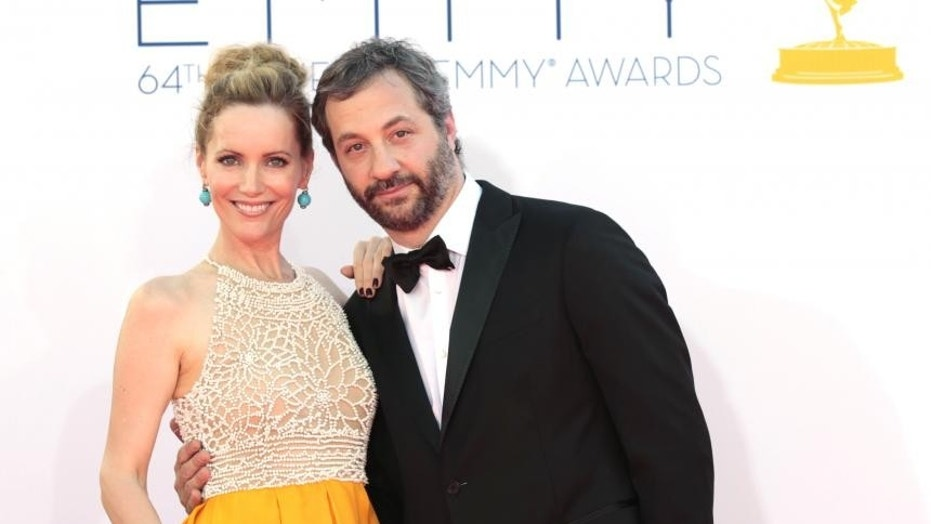 Judd Apatow poses with wife Leslie Mann.