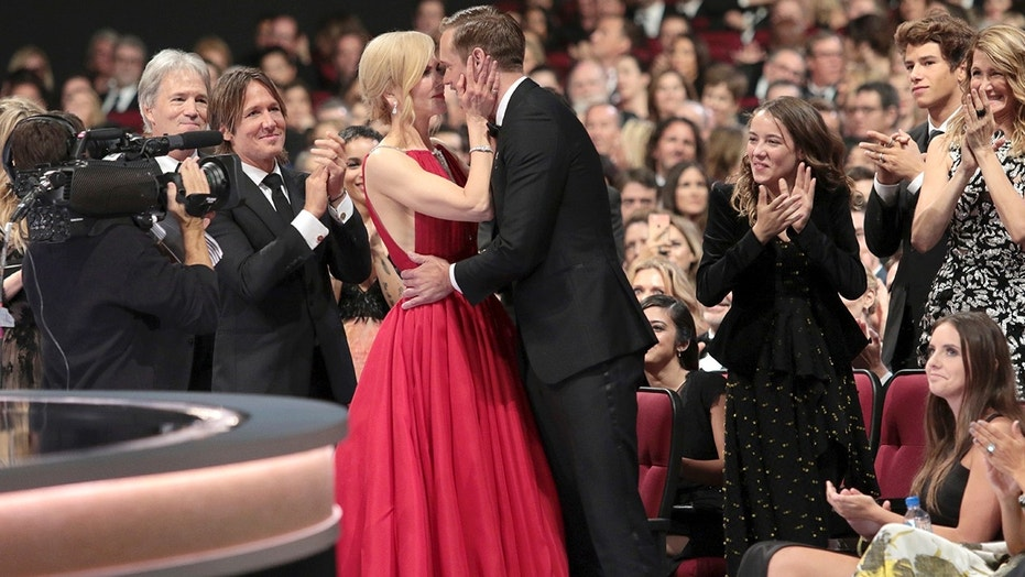 "IMAGE DISTRIBUTED FOR THE TELEVISION ACADEMY - Nicole Kidman, left, congratulates Alexander Skarsgard after winning the award for outstanding supporting actor in a limited series or a movie for ""Big Little Lies"" at the 69th Primetime Emmy Awards on Sunday, Sept. 17, 2017, at the Microsoft Theater in Los Angeles. (Photo by Alex Berliner/Invision for the Television Academy/AP Images)"