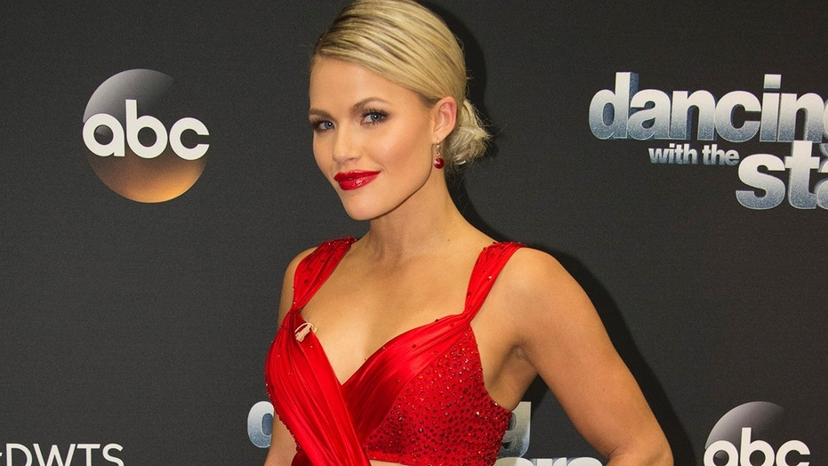 Witney Carson poses on the carpet.
