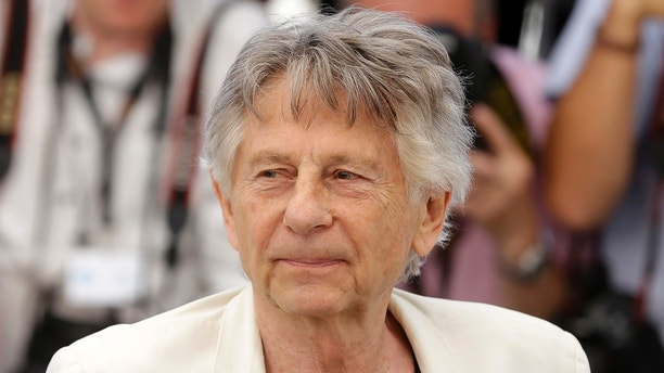 "FILE - In this May 27, 2017 photo, director Roman Polanski appears at the photo call for the film, ""Based On A True Story,"" at the 70th international film festival, Cannes, southern France. A lawyer for Polanski says his sex crime victim will appeal to a judge to end the case against him. Attorney Harland Braun said Samantha Geimer will appear Friday, June 9, 2017 in Los Angeles Superior Court to help make the case that Polanski has served his time for the 40-year-old crime. (AP Photo/Alastair Grant, File)"