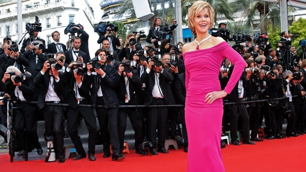 "Actress Jane Fonda poses on the red carpet as she arrives for the screening of the film ""Inside Llewyn Davis"" in competition during the 66th Cannes Film Festival in Cannes May 19, 2013.        REUTERS/Jean-Paul Pelissier (FRANCE  - Tags: ENTERTAINMENT)   - RTXZT5Q"