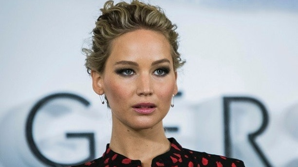 "FILe - In this Dec. 1, 2016, file photo, actress Jennifer Lawrence poses for photographers during a photo call to promote the film ""Passengers,"" in London. Lawrence condemned Harvey Weinstein in a statement released early Tuesday, Oct. 10, 2017, but said he never sexually harassed her and she had no first-hand knowledge of any harassment allegations. (Photo by Vianney Le Caer/Invision/AP, File)"