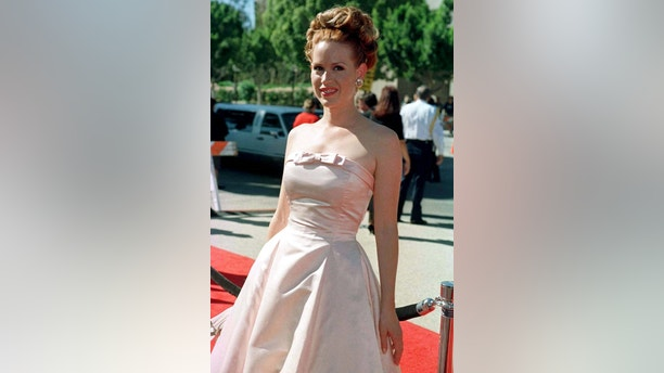 Actress Molly Ringwald arrives September 8 for the 48th Annual Emmy Awards in Pasadena. Ringwald is wearing a gown by designer Issac Mizrahi. - PBEAHUMWVEH