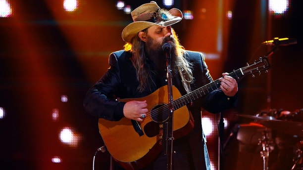 Chris Stapelton performs at 2017 CMT Artist of the Year Awards at Nashville's Schermerhorn Symphony Center on Wednesday, Oct. 18, 2017, in Nashville, Tenn.