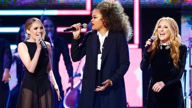 Andra Day, center, Lee Ann Womack, right and Danielle Bradbery perform at 2017 CMT Artist of the Year Awards at Nashville's Schermerhorn Symphony Center on Wednesday, Oct. 18, 2017, in Nashville, Tenn.