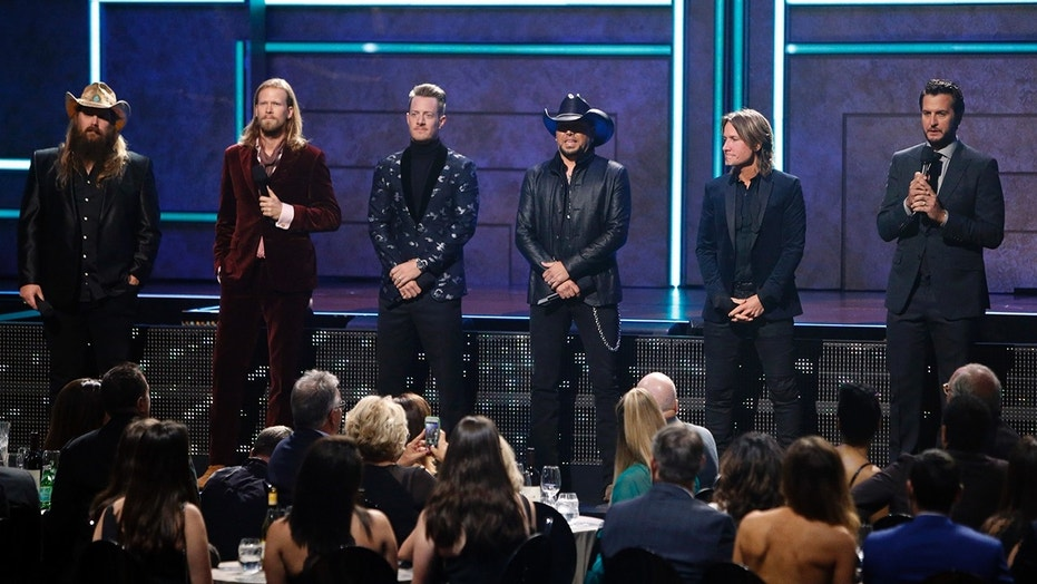 From l to r: Chris Stapelton, Brian Kelly, Tyler Hubbard, Jason Aldean, Keith Urban and Luke Bryan are seen at 2017 CMT Artist of the Year Awards at Nashville's Schermerhorn Symphony Center on Wednesday, Oct. 18, 2017, in Nashville, Tenn.