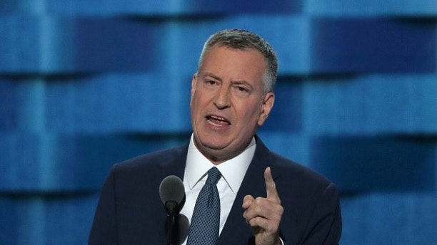 PHILADELPHIA, PA - JULY 27:  New York City Mayor Bill De Blasio delivers remarks on the third day of the Democratic National Convention at the Wells Fargo Center, July 27, 2016 in Philadelphia, Pennsylvania. Democratic presidential candidate Hillary Clinton received the number of votes needed to secure the party's nomination. An estimated 50,000 people are expected in Philadelphia, including hundreds of protesters and members of the media. The four-day Democratic National Convention kicked off July 25.  (Photo by Alex Wong/Getty Images)