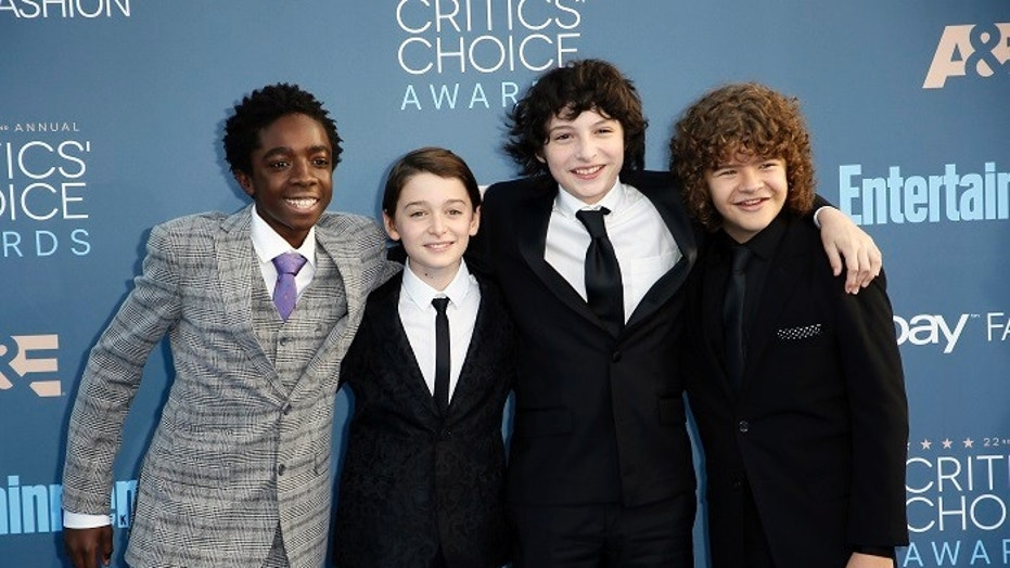 """Stranger Things"" star Finn Wolfhard (pictured second from right) fired his agent who was accused of sexual assault."