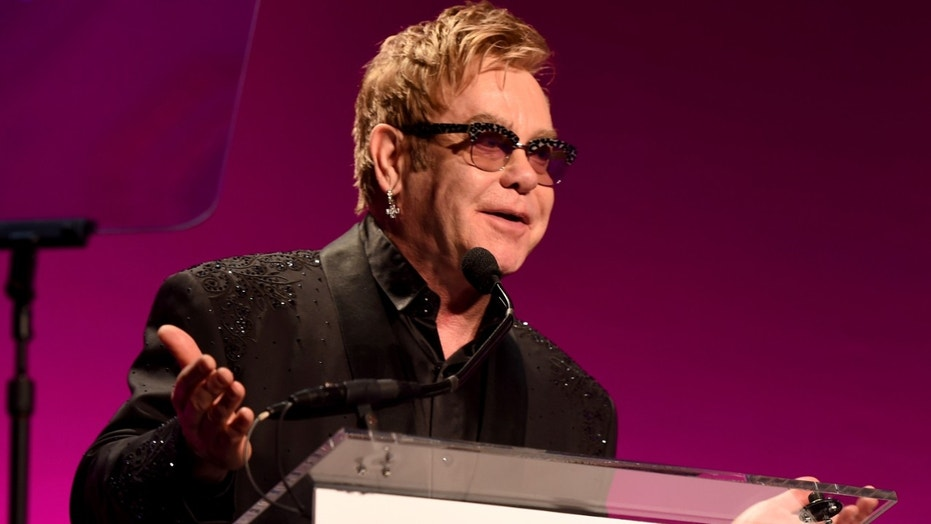 NEW YORK, NY - OCTOBER 28:  Founder Sir Elton John speaks on stage at the Elton John AIDS Foundation's 13th Annual An Enduring Vision Benefit at Cipriani Wall Street on October 28, 2014 in New York City.  (Photo by Larry Busacca/Getty Images)