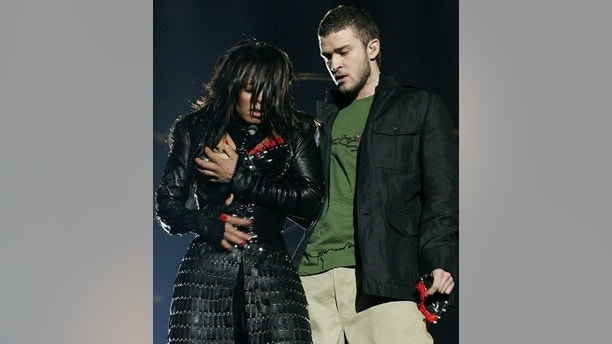 Janet Jackson (L) reacts after fellow singer Justin Timberlake ripped off one of her chest plates at the end of their half time performance at Super Bowl XXXVIII in Houston, February 1, 2004. Jackson turned heads on Sunday night during a half-time appearance with Timberlake during the Carolina Panthers-New England Patriots game, bumping and grinding through a duet. Just as the song came to its close, Timberlake reached for Jackson and tore part of her black leather bustier, revealing one breast.  REUTERS/Win McNamee - RP4DRIBQZIAA