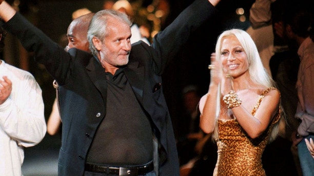 Italian stylist Gianni Versace (L) and his sister Donatella (R) at end of the Versace menswear show in Milan yesterday night June 29, 1996.