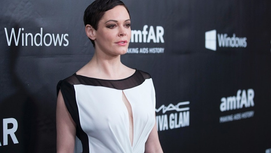 Rose McGowan arrives at amfAR's ffth annual Inspiration Gala in Los Angeles, Oct. 29, 2014.