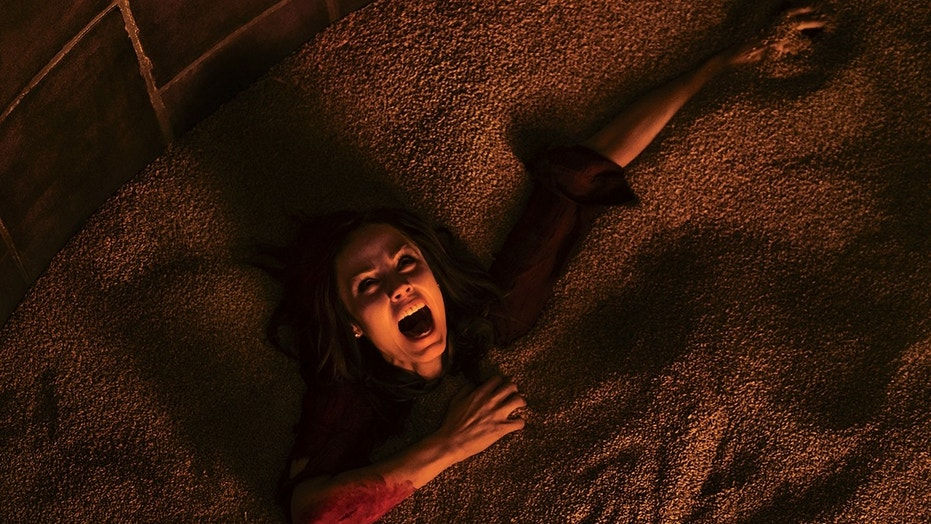 "This image released by Lionsgate shows Laura Vandervoort in the horror film, ""Jigsaw."" (Brooke Palmer/Lionsgate via AP)"