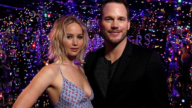 Cast members Jennifer Lawrence and Chris Pratt pose during a photo call for the movie