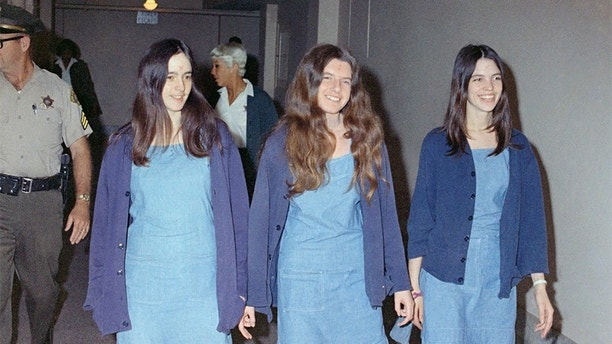FILE - Charles Manson followers, from left: Susan Atkins, Patricia Krenwinkel and Leslie Van Houten, shown walking to court to appear for their roles in the 1969 cult killings of seven people, including pregnant actress Sharon Tate, in Los Angeles, Calif., in this Aug. 20, 1970 file photo. 44 years after she went to prison, Leslie Van Houten is an old woman with gray hair and wrinkles and she is facing her 20th parole hearing Wednesday June 5, 2013 with multiple forces arrayed against her bid for a chance at freedom in her old age. (AP Photo/George Brich, File)