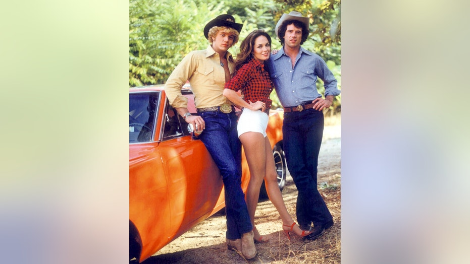 American actors (left to right) John Schneider, Catherine Bach and Tom Wopat in a promotional portrait for the TV show 'The Dukes of Hazzard', circa 1980. They play Bo, Daisy and Luke Duke, respectively. (Photo by Silver Screen Collection/Getty Images)