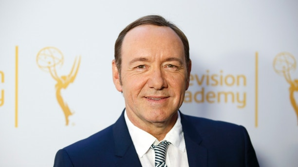 "Actor Kevin Spacey, outstanding lead actor in a drama series nominee for ""House of Cards,"" poses at the Television Academy's Performers Peer Group cocktail reception to celebrate the 66th Primetime Emmy Awards in Beverly Hills, California July 28, 2014.   REUTERS/Danny Moloshok   (UNITED STATES - Tags: ENTERTAINMENT) - RTR40GMW"