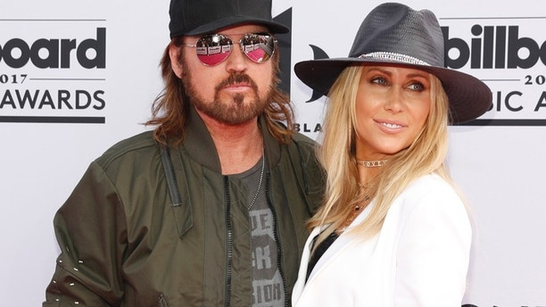 Billy Ray Cyrus (left) and Tish Cyrus arrive at the 2017 Billboard Music Awards in Las Vegas, Nevada, May 21, 2017.