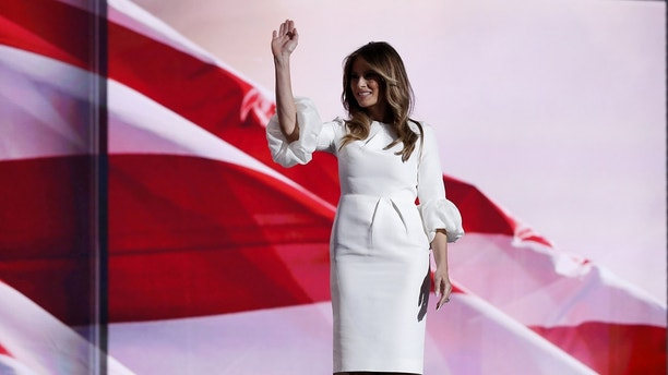 Melania Trump, wife of Republican U.S. presidential candidate Donald Trump, waves at the Republican National Convention in Cleveland, Ohio, U.S. July 18, 2016. REUTERS/Mark Kauzlarich - HP1EC7J08SV00