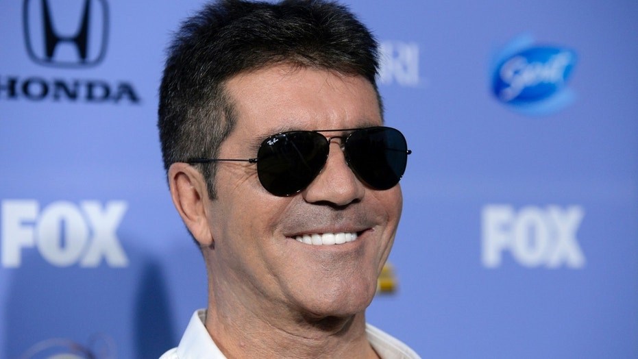 "Judge Simon Cowell attends ""The X Factor"" season three premiere event in West Hollywood, California September 5, 2013. REUTERS/Phil McCarten (UNITED STATES - Tags: ENTERTAINMENT PROFILE HEADSHOT) - RTX1398M"