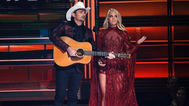 51st Country Music Association Awards – Show - Nashville, Tennessee, U.S., 08/11/2017 - Show hosts Brad Paisley and Carrie Underwood speak on stage. REUTERS/Mario Anzuoni - HP1EDB90492H3