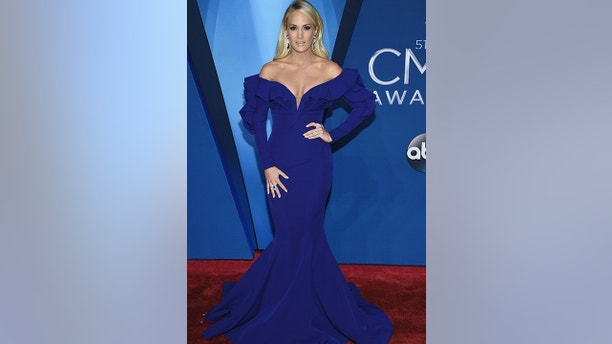Carrie Underwood arrives at the 51st annual CMA Awards on Wednesday, Nov. 8, 2017, in Nashville, Tenn. (Photo by Evan Agostini/Invision/AP)