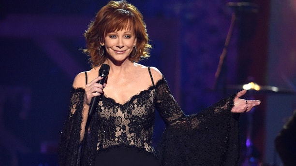 "Reba McEntire performs ""Legends"" at the 51st annual CMA Awards at the Bridgestone Arena on Wednesday, Nov. 8, 2017, in Nashville, Tenn. (Photo by Chris Pizzello/Invision/AP)"