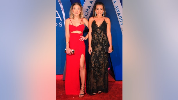 51st Country Music Association Awards – Arrivals - Nashville, Tennessee, U.S., 08/11/2017 - Maddie Marlow (L) and Taylor Dye of Maddie & Tae.  REUTERS/Harrison Mcclary - HP1EDB81TMF7J
