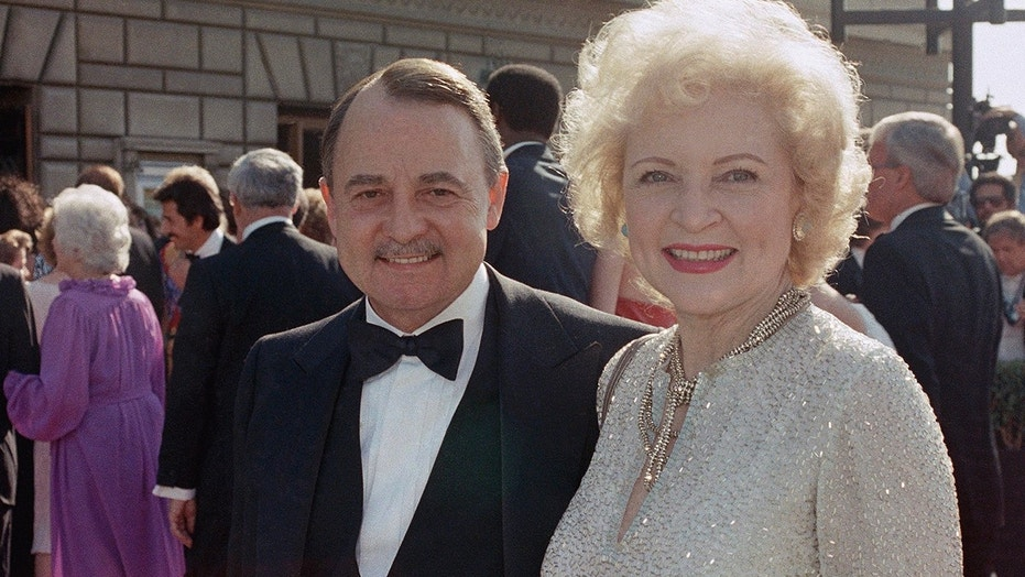 "FILE- This Sept. 22, 1985, file photo shows John Hillerman, left, and Betty White, right, arriving at Emmy Awards in Pasadena, Calif. A spokeswoman for the family of Hillerman says the co-star of TV's ""Magnum, P.I."" has died. Hillerman was 84. Spokeswoman Lori De Waal said Hillerman died Thursday at his home in Houston. She said the cause of death has yet to be determined. (AP Photo/LIU, File)"