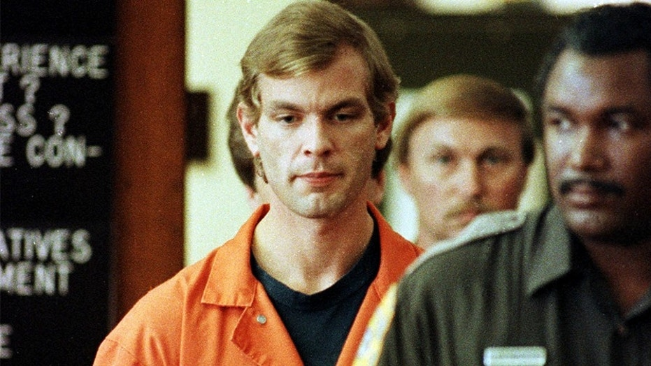 Serial killer Jeffrey Dahmer is escorted into a Milwaukee County Circuit Court by a Milwaukee County Sheriffs Deputy for his second appearance in this July 1991 file photo.
