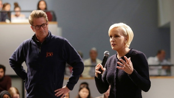 "MSNBC television anchors Joe Scarborough, left, and Mika Brzezinski, right, co-hosts of the show ""Morning Joe,"" take questions from an audience, Wednesday, Oct. 11, 2017, at a forum called Harvard Students Speak Up: A Town Hall on Politics and Public Service, at the John F. Kennedy School of Government, on the campus of Harvard University, in Cambridge, Mass. (AP Photo/Steven Senne)"