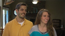 Derick and Jill after opening the baby mobile package.
