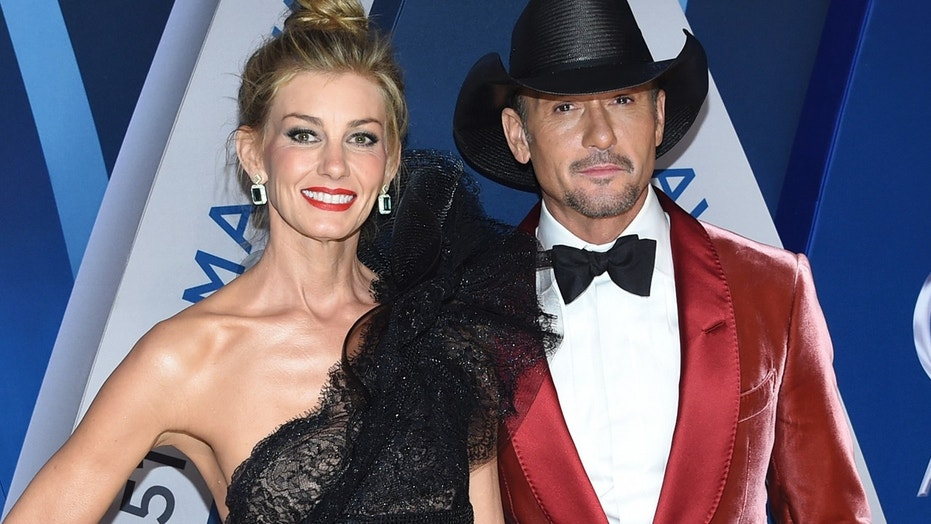 Faith Hill, left, and Tim McGraw arrive at the 51st annual CMA Awards on Wednesday, Nov. 8, 2017, in Nashville, Tenn.