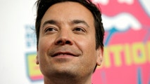 "Actor and television host Jimmy Fallon poses for photographers as he arrives for the opening of the new exhibit ""Exhibitionism: The Rolling Stones"" in the Manhattan borough of New York City, U.S., November 15, 2016.  REUTERS/Mike Segar - S1BEUNCFSMAA"