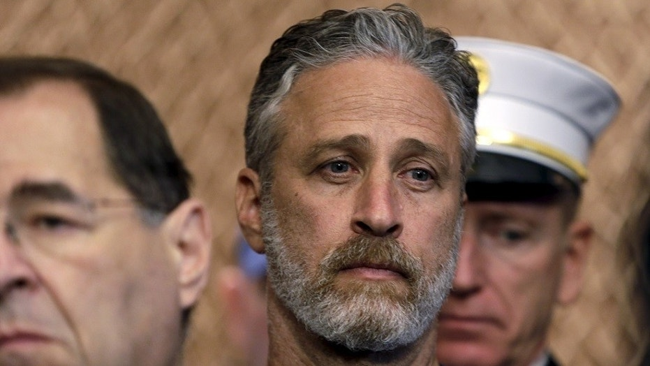 Comedian/director Jon Stewart (C) listens during at an event to urge U.S. lawmakers to re-authorize the Zadroga Bill at the U.S. Capitol in Washington September 16, 2015. The group appeared on Capitol Hill in an effort to extend the James Zadroga 9/11 Health & Compensation Act for first responders who suffer from serious and prolonged health ailments from the 9/11 attacks on New York City.  REUTERS/Gary Cameron     - GF10000208428